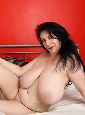 Blonde cougar ass stripping slowly on loveseat