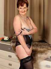 Mature in black lingerie acts naughty in slutty scenes