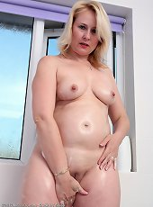 Hot big ass milf Elexis Monroe posing in peignoir