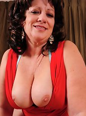 Thick and busty mature house Cheryll Stone spreads her pussy.
